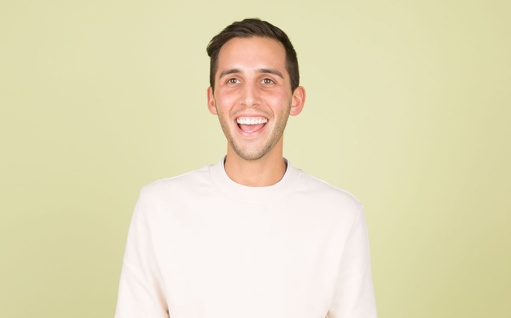 Smiling man with a blank yellow background