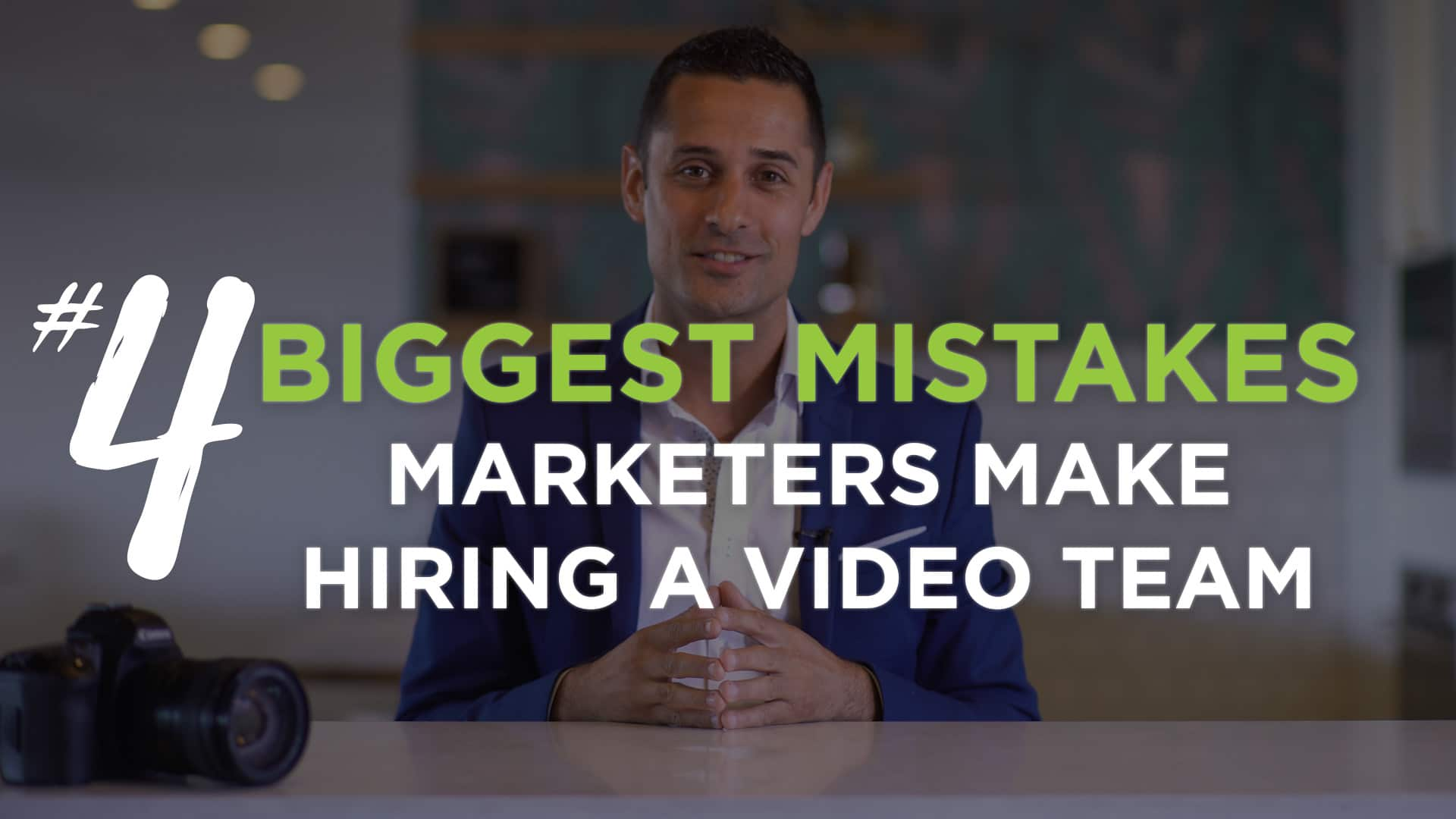 A person sitting at a table. Text saying: 4 Biggest Mistakes Marketers Make Hiring A Video Team