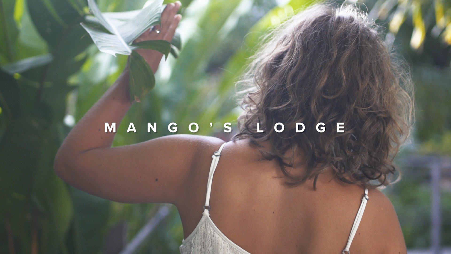 Woman walking in a jungle-like vacation rental
