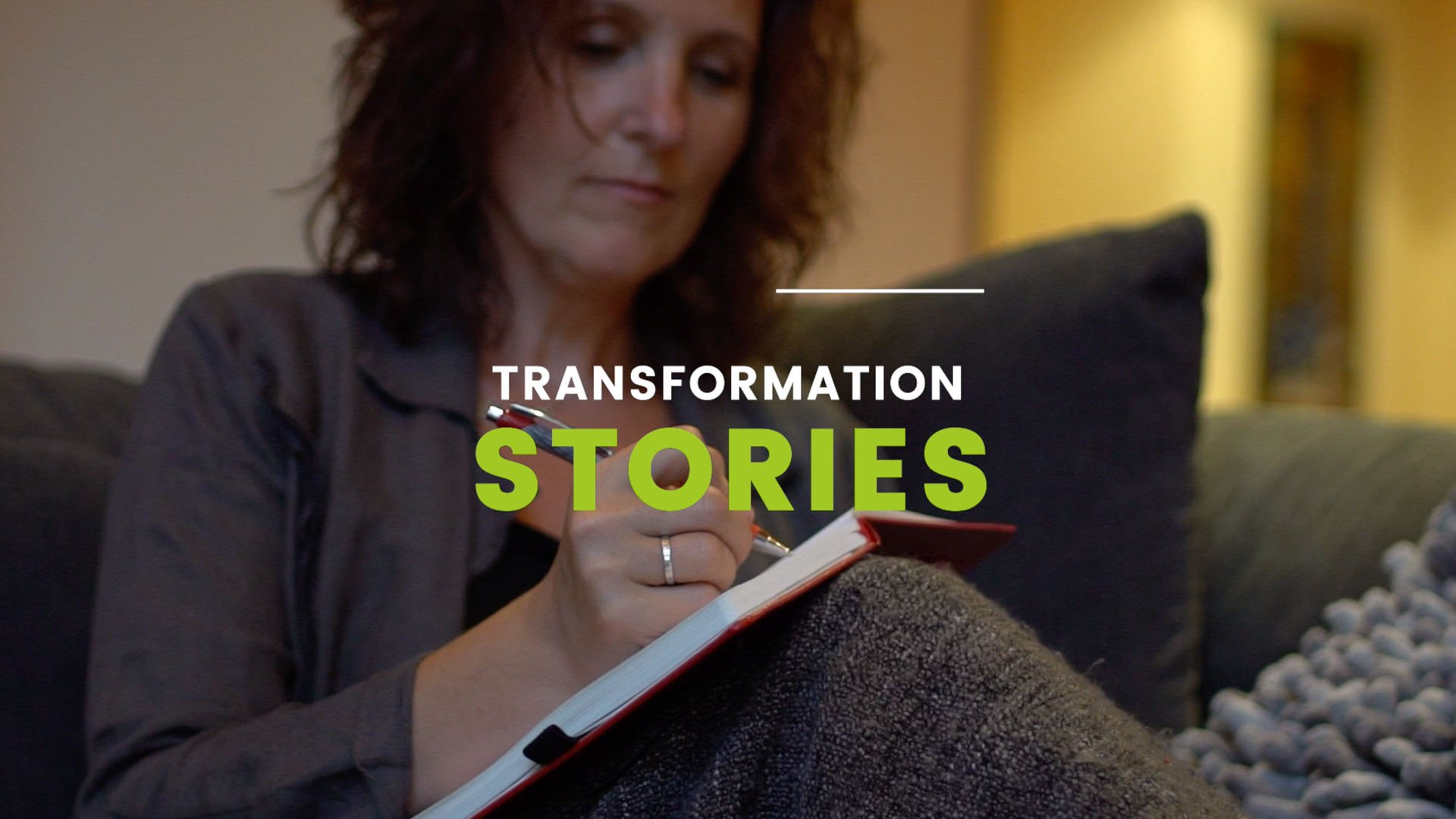 Woman writing in a book - thumbnail image of the testimonial video