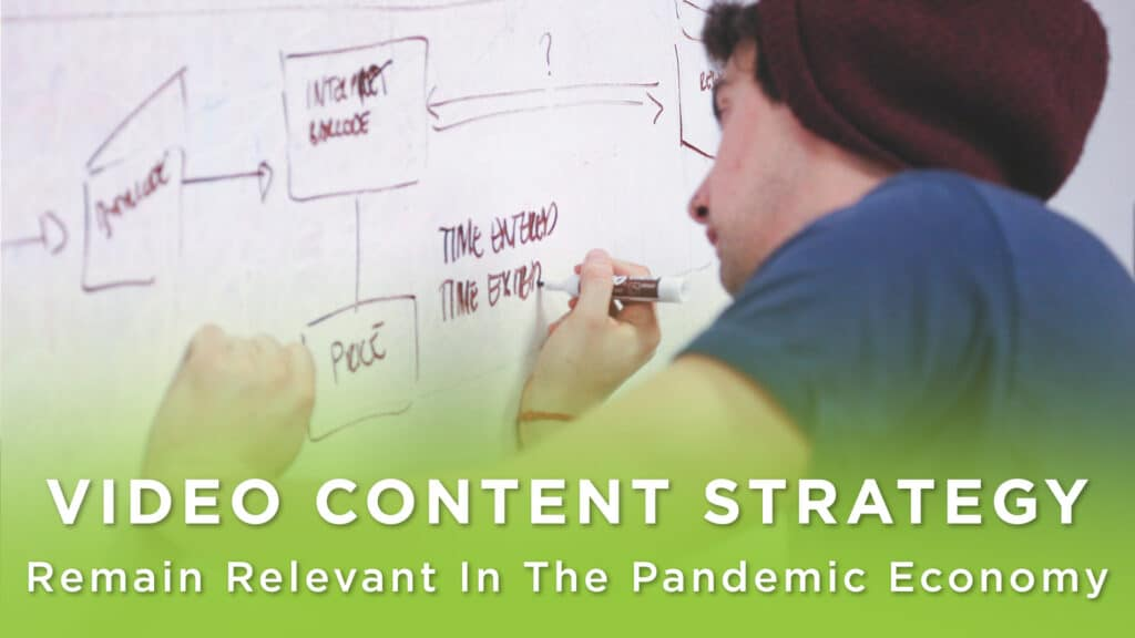 Young man writes a video marketing strategy on a whiteboard