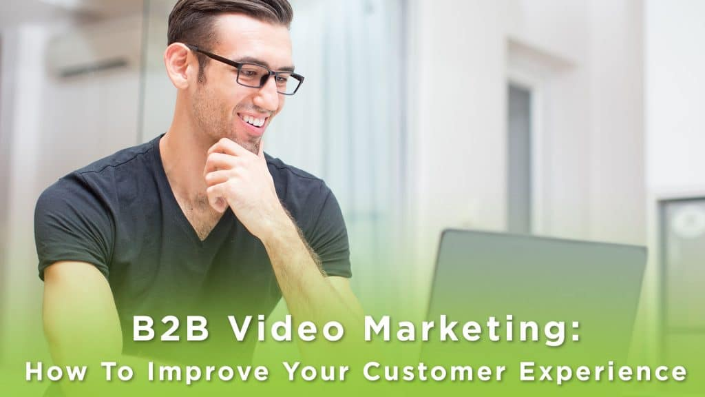 A young handsome man looking at a laptop smiling. Text says: B2B Video Marketing