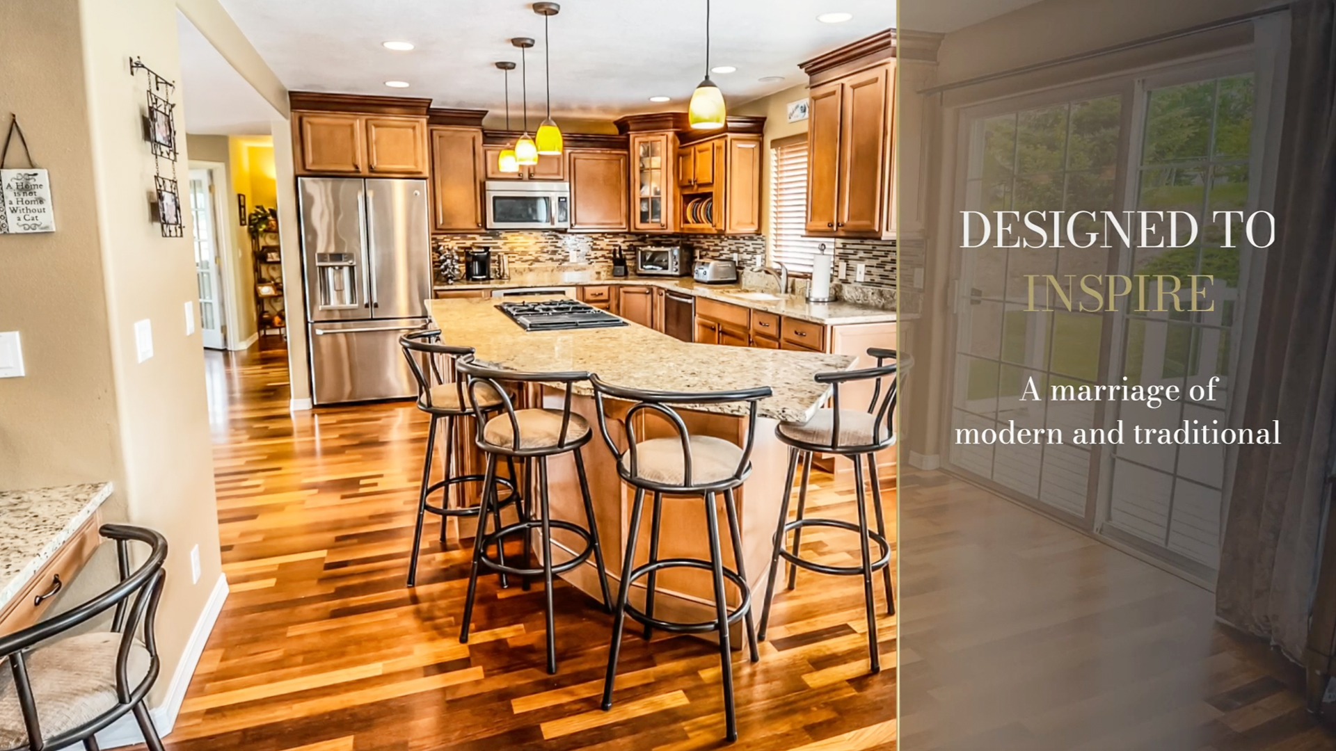 Beautiful kitchen with a side bar text overlay which read DESIGNED TO INSPIRE - A marriage of modern and traditional