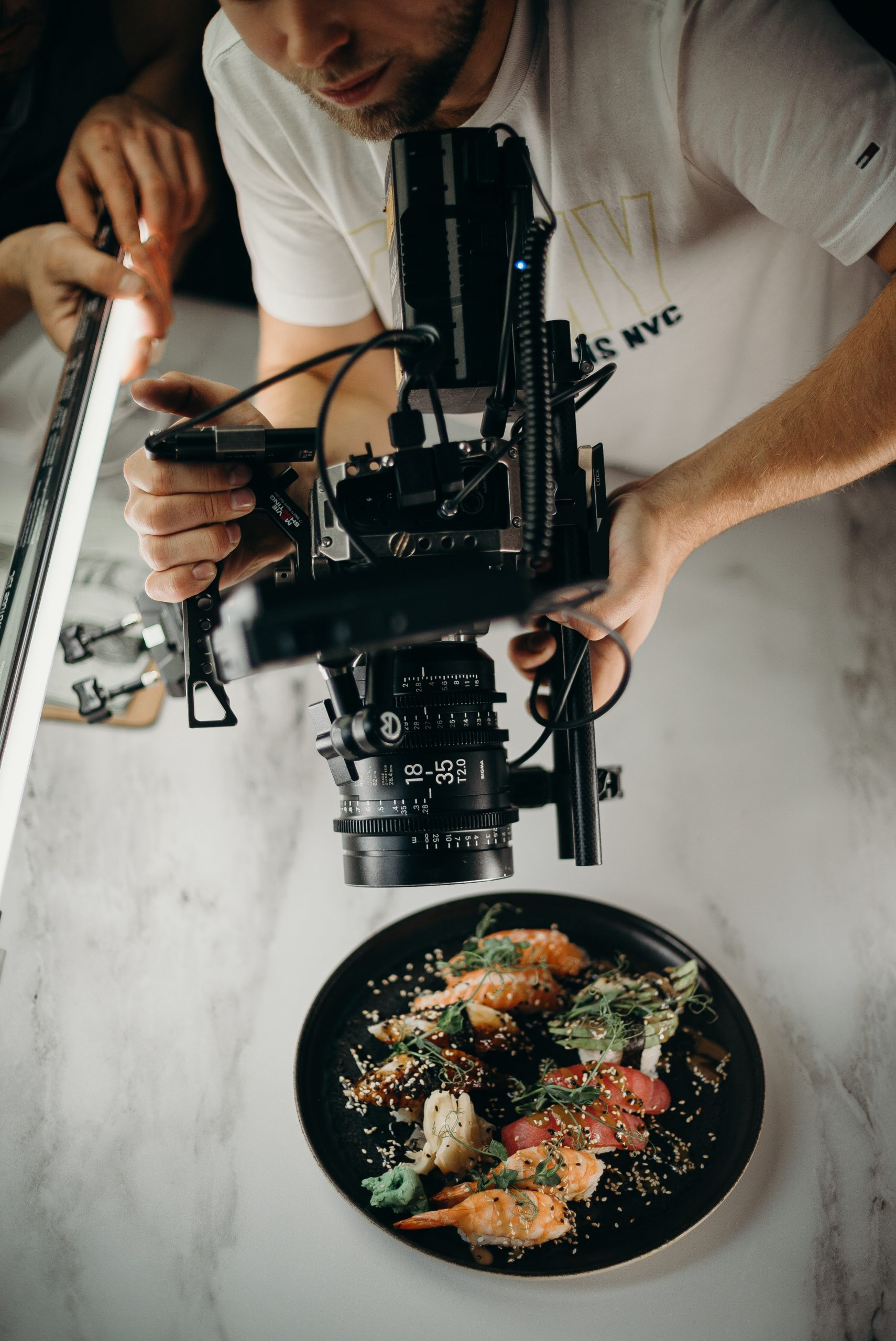 video production team filming close up of sushi platter