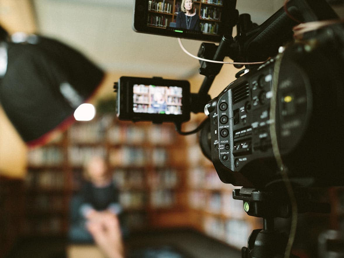 A close up of a camera during a video production session