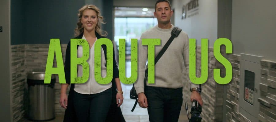 2 owners of UpMedia walking toward the camera. Text graphic that says