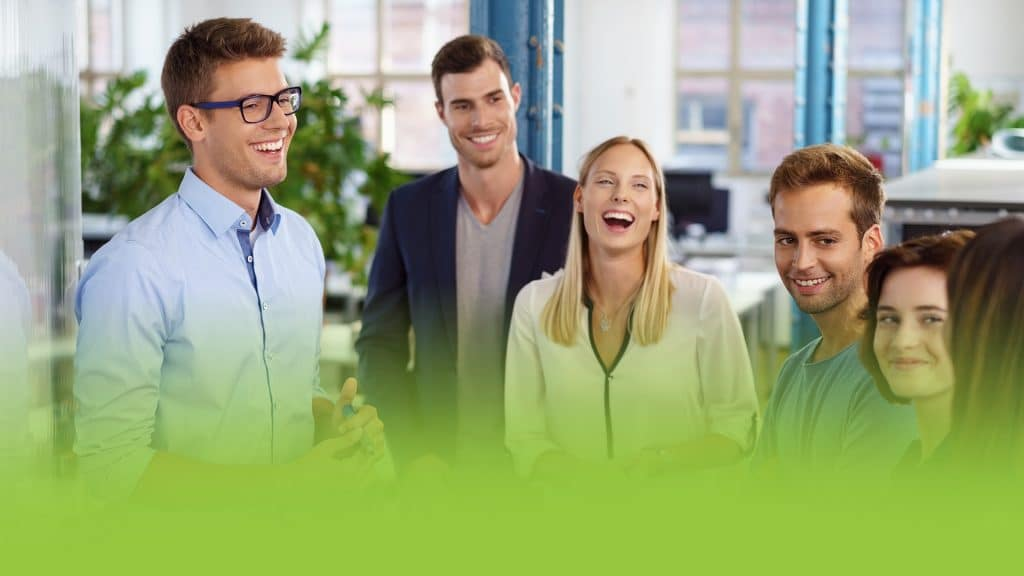 A group of office workers laughing together. Showing a scene of company culture.